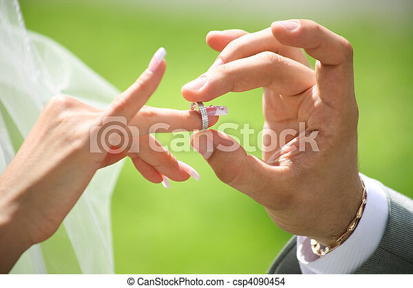 Exchange of wedding rings Closeup of grooms hand putting stock
