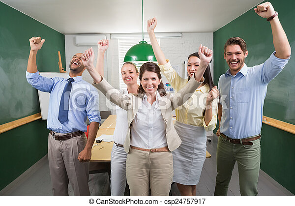Excited business team cheering at camera - csp24757917
