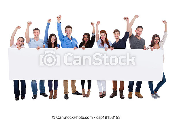 Excited group of diverse people holding banner - csp19153193