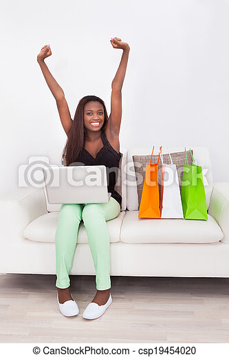 Excited Woman Shopping Online At Home - csp19454020