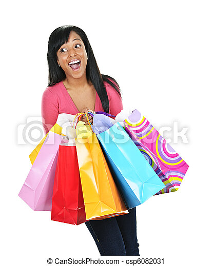 Excited young black woman with shopping bags - csp6082031
