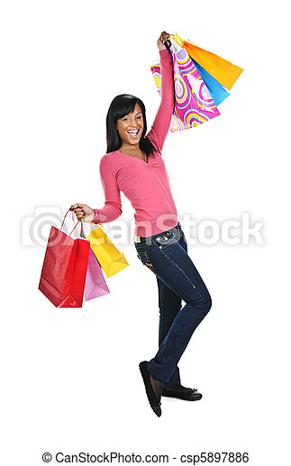 Excited young black woman with shopping bags - csp5897886