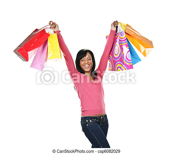 Excited young black woman with shopping bags - csp6082029