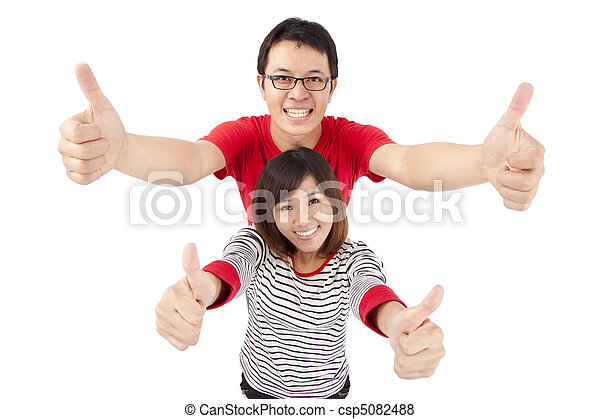 Excited young couple celebrating with thumb up - csp5082488
