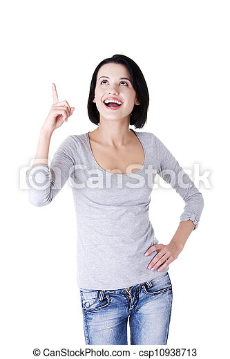 Excited young woman pointing on copy space - csp10938713