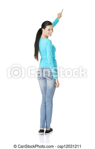 Excited young woman pointing on copy space - csp12031211