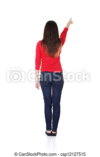 Excited young woman pointing on copy space - csp12127515