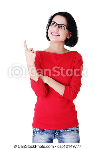 Excited young woman pointing on copy space - csp12149777