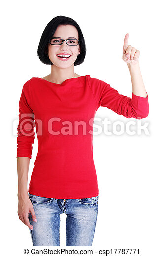 Excited young woman pointing on copy space - csp17787771
