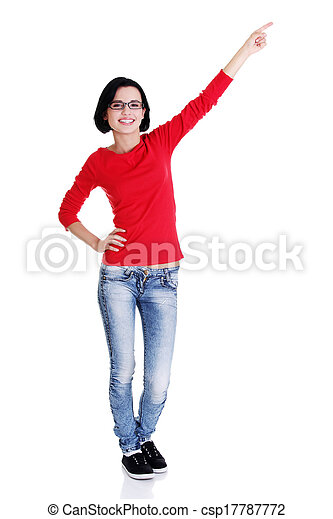 Excited young woman pointing on copy space - csp17787772