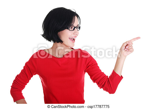 Excited young woman pointing on copy space - csp17787775