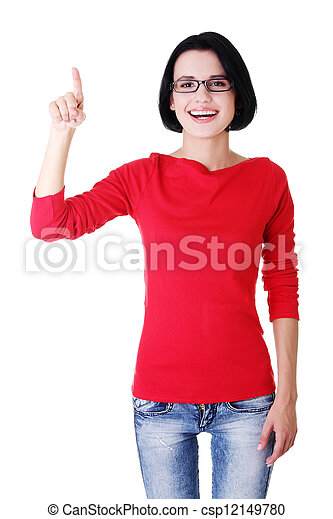 Excited young woman pointing on copy space - csp12149780