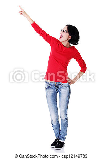 Excited young woman pointing on copy space - csp12149783