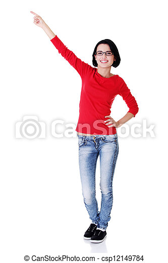Excited young woman pointing on copy space - csp12149784
