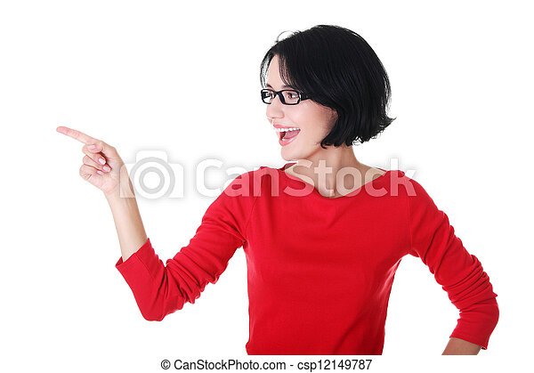 Excited young woman pointing on copy space - csp12149787