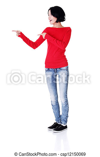Excited young woman pointing on copy space - csp12150069