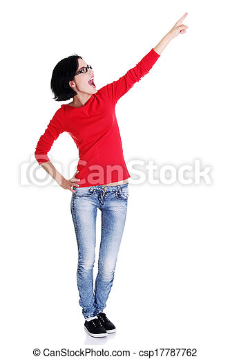 Excited young woman pointing on copy space - csp17787762