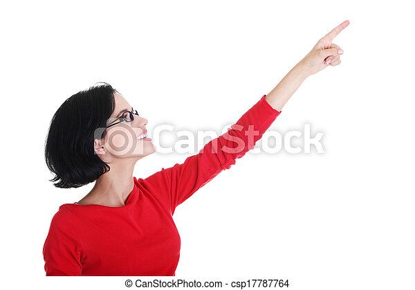 Excited young woman pointing on copy space - csp17787764