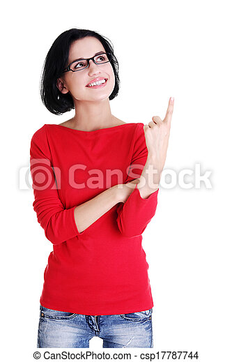 Excited young woman pointing on copy space - csp17787744