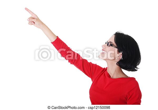Excited young woman pointing on copy space - csp12150098