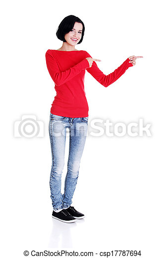 Excited young woman pointing on copy space - csp17787694