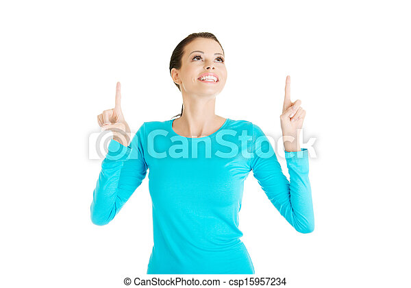 Excited young woman pointing on copy space - csp15957234