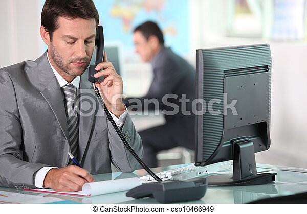 executive on the phone in office - csp10466949