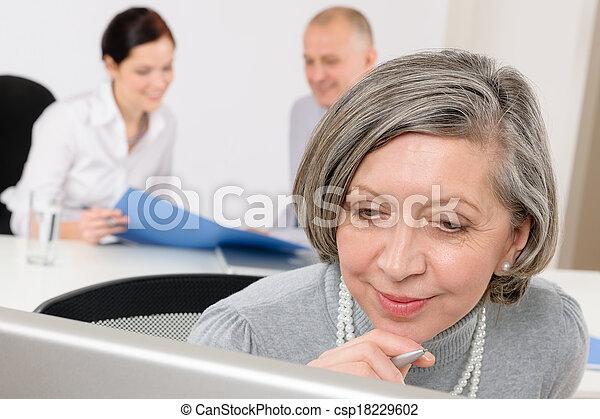 Executive senior woman business team meeting - csp18229602