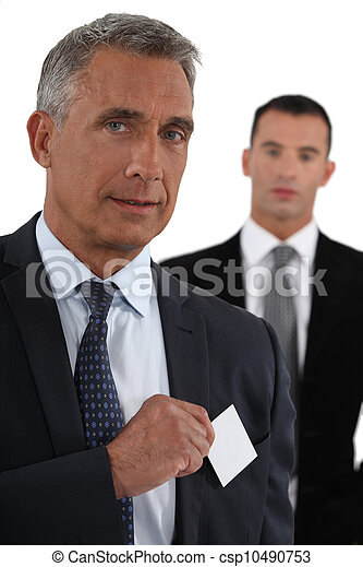 Executive with a blank business card - csp10490753