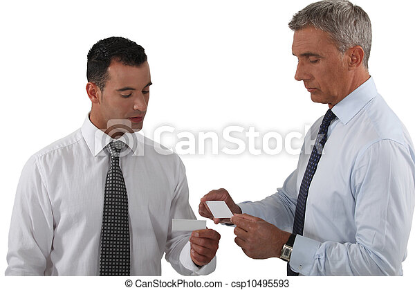 Executives exchanging business cards - csp10495593