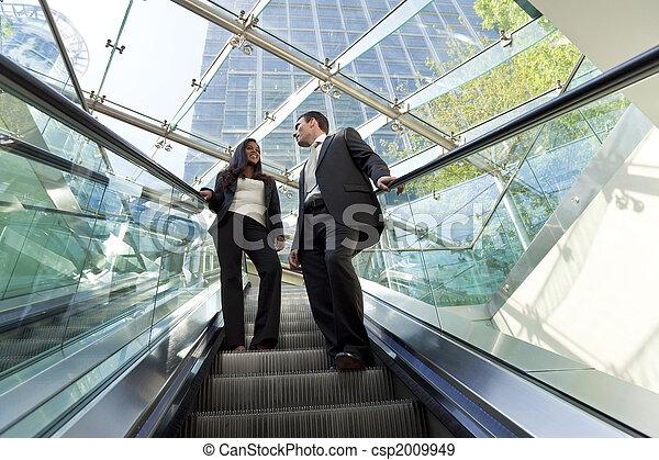 Executives on an Escalator - csp2009949