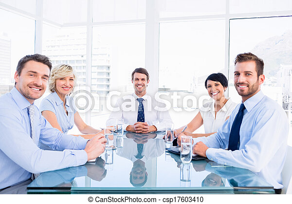 Executives sitting around conference table - csp17603410