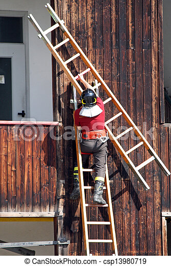 exercise and training of firefighters in the fire station with wooden ladder - csp13980719