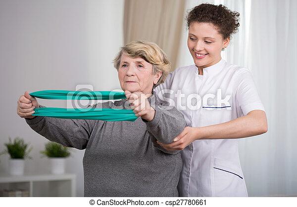 Exercising elderly woman - csp27780661