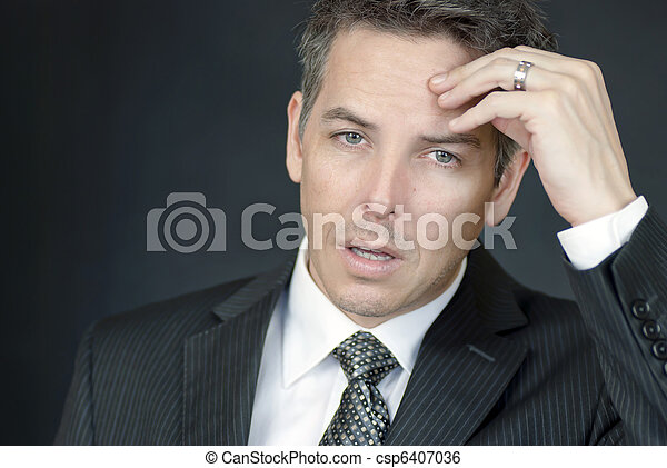 Exhausted Businessman Looks To Camera - csp6407036