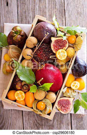 Exotic fruits in a wooden crate - csp29606180