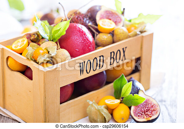 Exotic fruits in a wooden crate - csp29606154