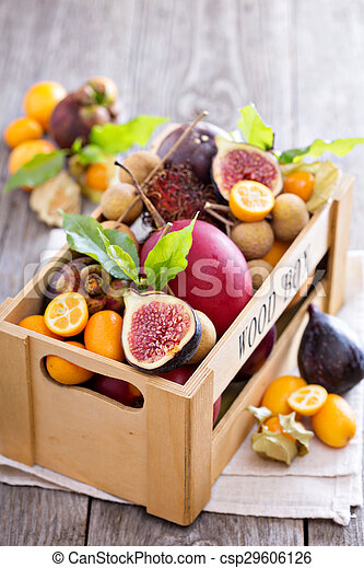 Exotic fruits in a wooden crate - csp29606126