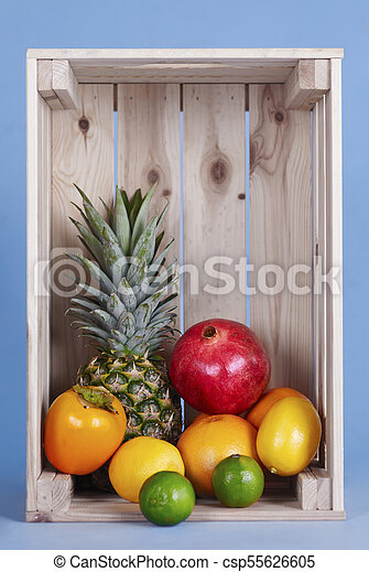 Exotic fruits in wooden crate - csp55626605