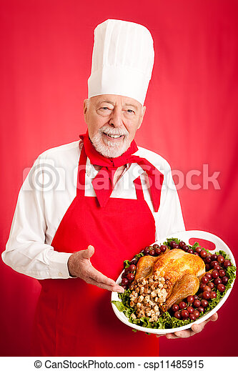 Experienced Chef Holding Holiday Dinner - csp11485915