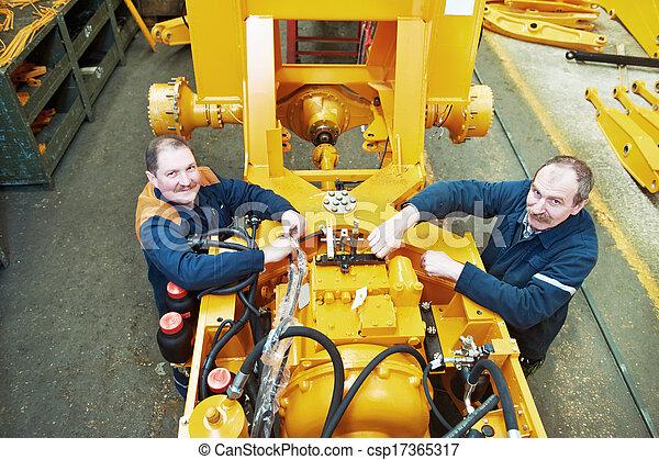 experienced industrial assembler workers - csp17365317