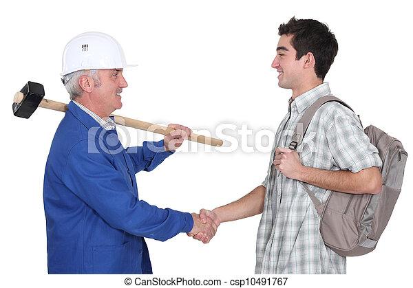 Experienced tradesman meeting his new apprentice - csp10491767