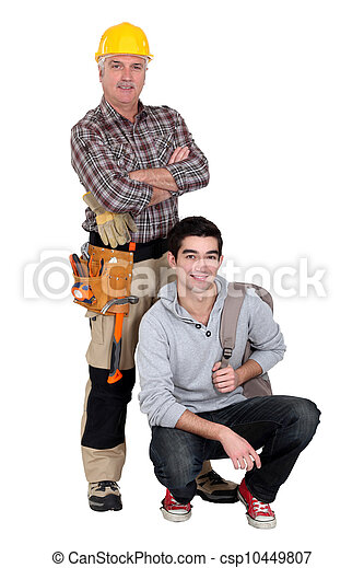 Experienced tradesman posing with his new apprentice - csp10449807