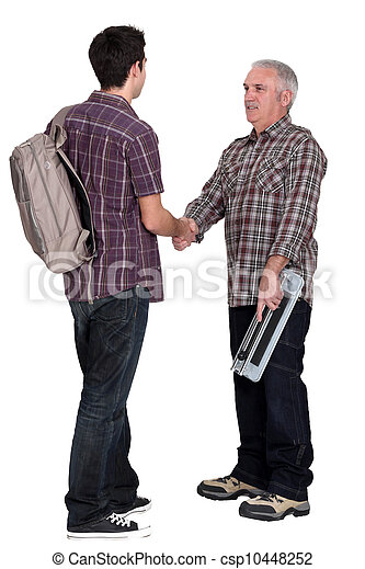 Experienced tradesman welcoming his new apprentice - csp10448252