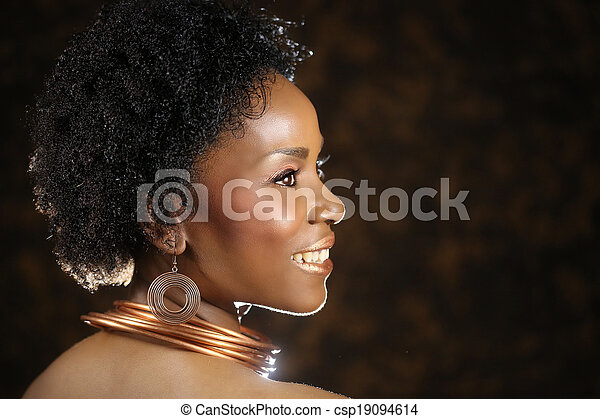 Expressive African American Woman With Dramatic Lighting - csp19094614