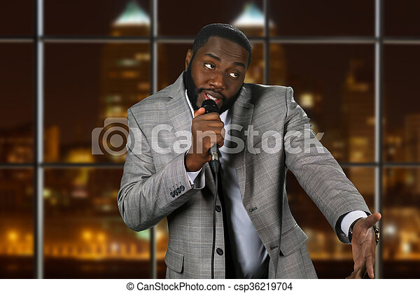 Expressive black man with microphone. - csp36219704