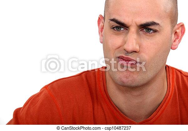 Expressive man pouting - csp10487237