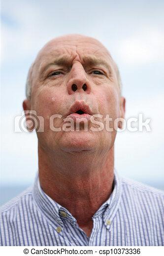 Expressive man whistling - csp10373336