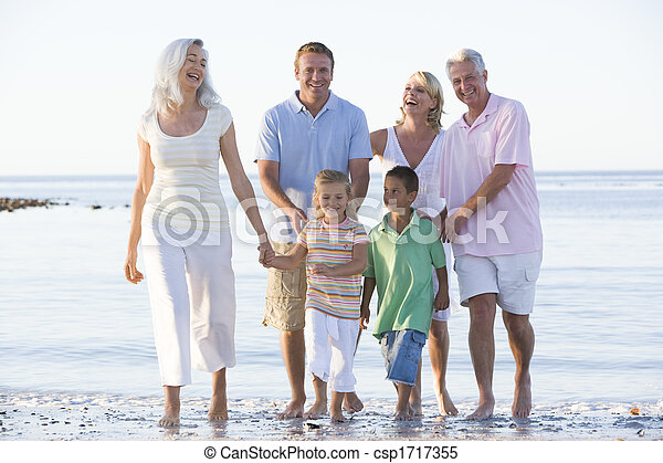 Extended family at the beach smiling - csp1717355