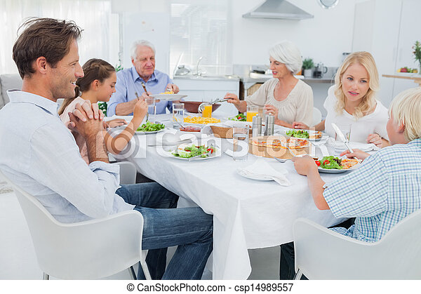 Extended family at the dinner table - csp14989557